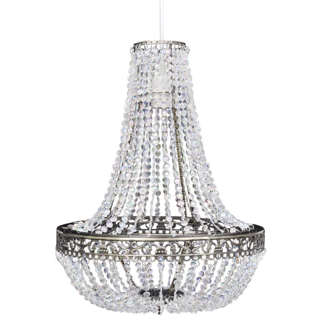 Mooie kroonluchter met een klassiek en elegant ontwerp en luxueuze uitstraling voor in huis of in uw bedrijf. De heldere kristallen vangen en reflecteren het licht in vele kleuren. Een peer wordt niet meegeleverd.