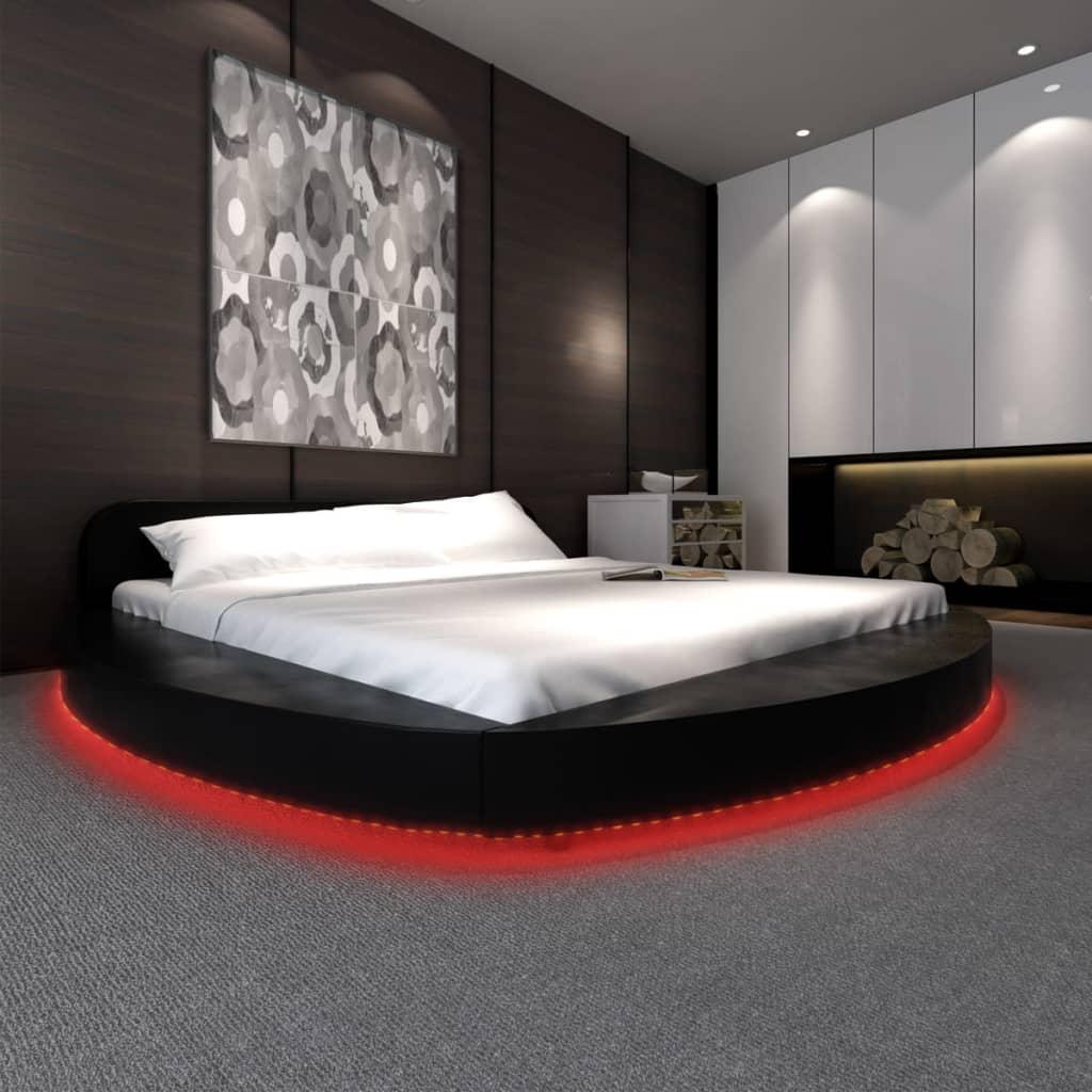 der kunstlederbett rundbett schwarz mit led leiste 180x200. Black Bedroom Furniture Sets. Home Design Ideas